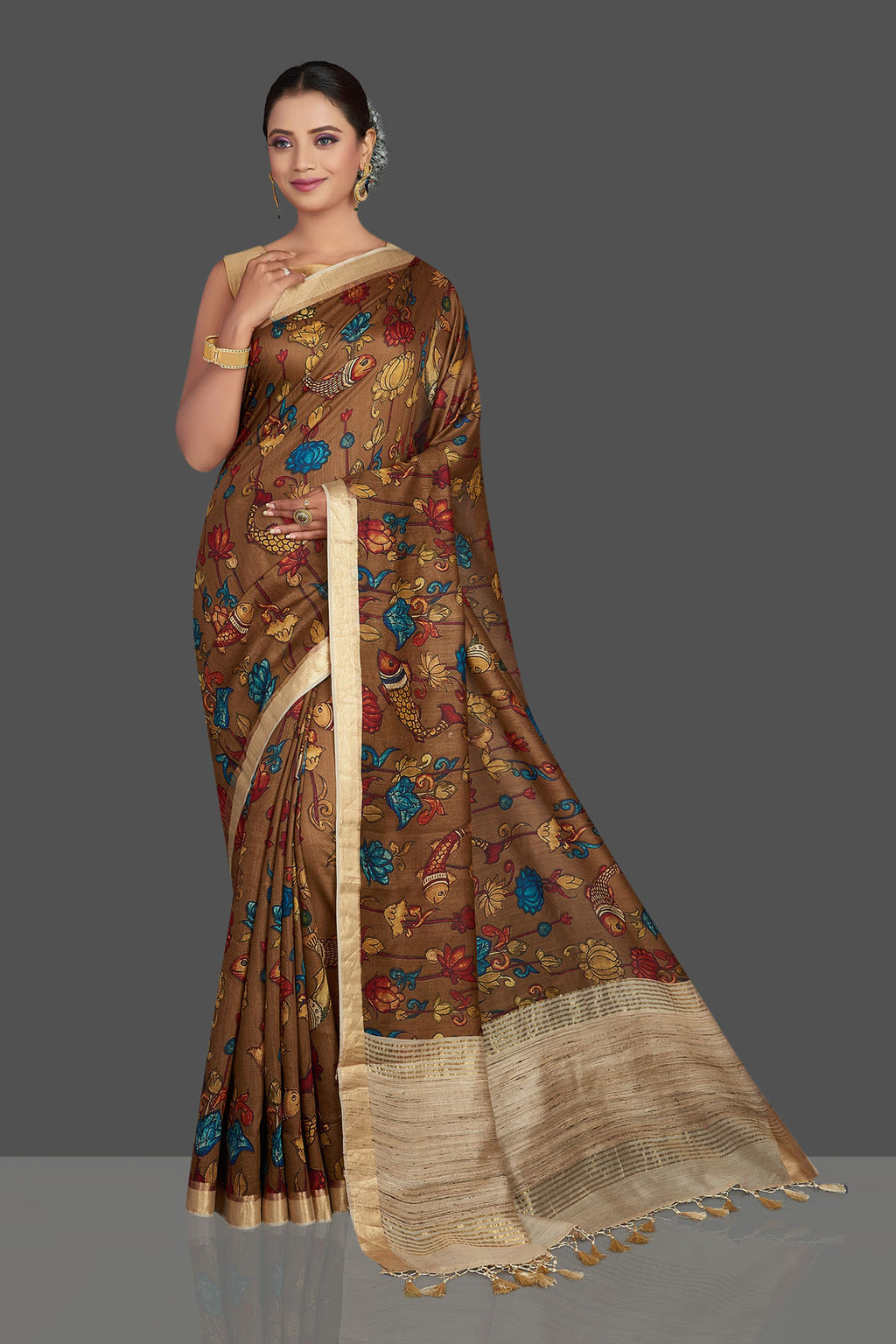Buy stunning brown printed tussar Banarasi saree online in USA with beige pallu. Look your best on special occasions with stunning Banarasi saris, pure silk sarees, tussar sarees, handwoven sarees from Pure Elegance Indian saree store in USA.-full view