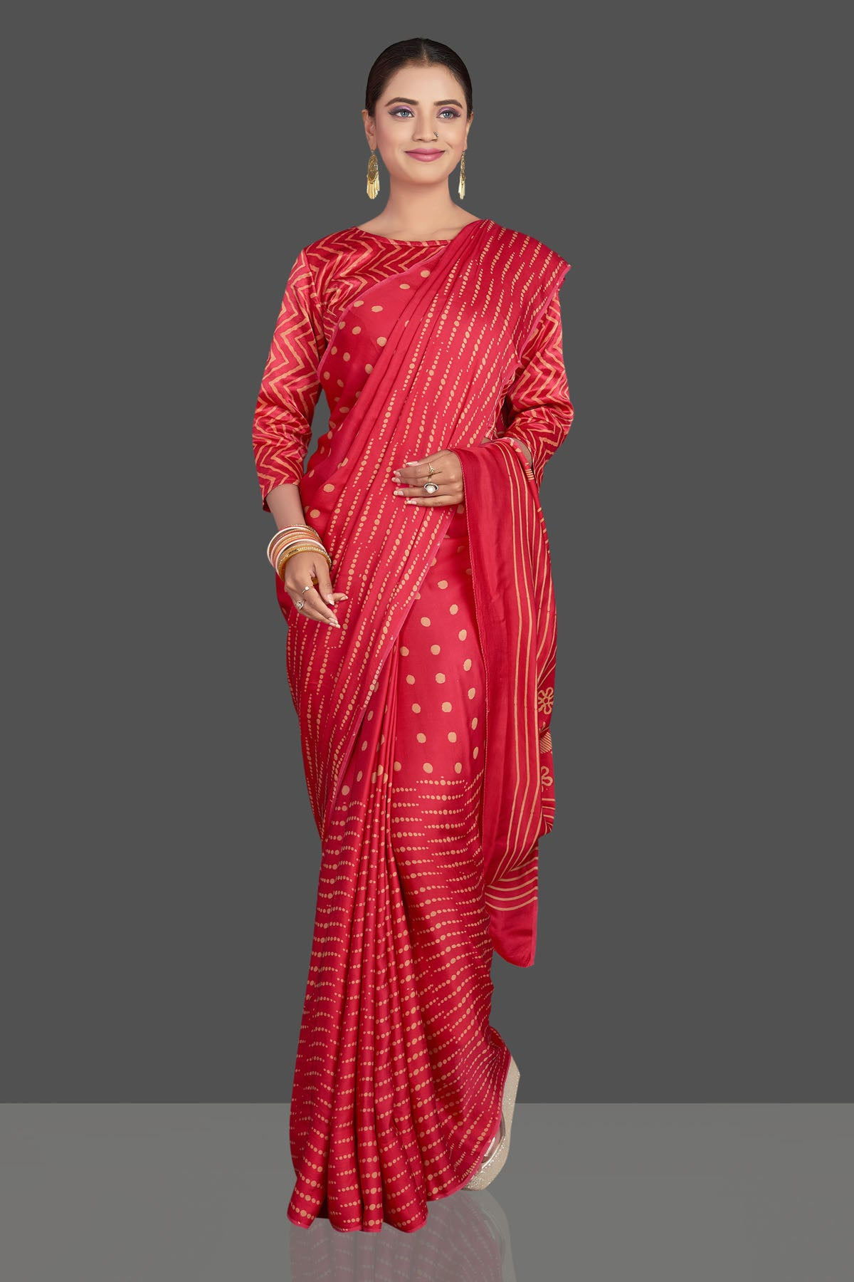 Buy gorgeous red printed modal silk sari online in USA. Make your presence felt on special occasions in beautiful embroidered sarees, handwoven sarees, pure silk sarees, tussar sarees from Pure Elegance Indian saree store in USA.-front