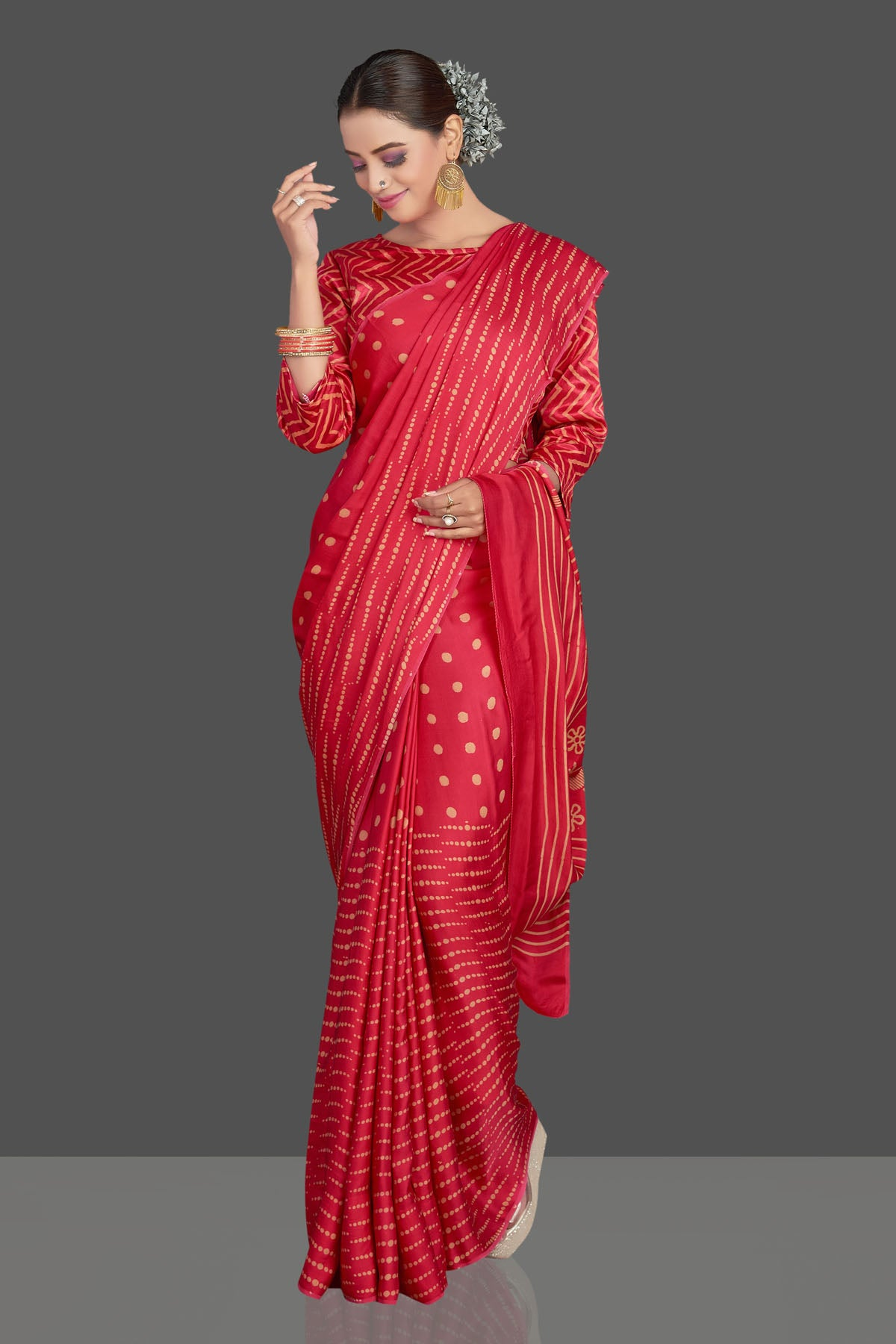 Buy gorgeous red printed modal silk sari online in USA. Make your presence felt on special occasions in beautiful embroidered sarees, handwoven sarees, pure silk sarees, tussar sarees from Pure Elegance Indian saree store in USA.-side