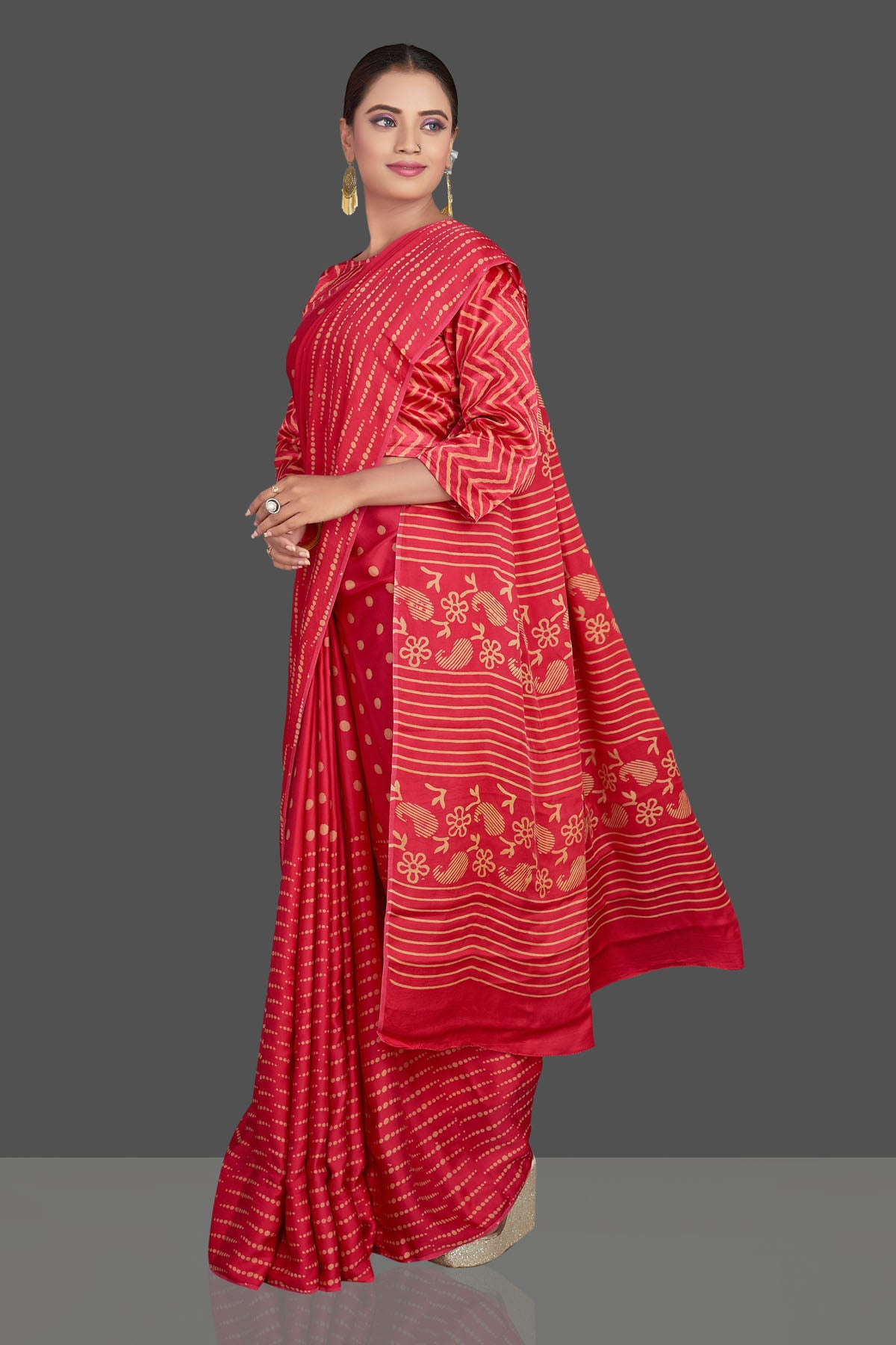 Buy gorgeous red printed modal silk sari online in USA. Make your presence felt on special occasions in beautiful embroidered sarees, handwoven sarees, pure silk sarees, tussar sarees from Pure Elegance Indian saree store in USA.-left