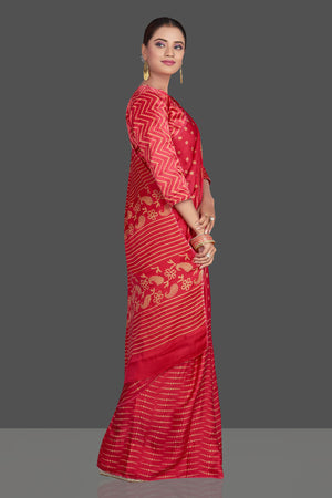 Buy gorgeous red printed modal silk sari online in USA. Make your presence felt on special occasions in beautiful embroidered sarees, handwoven sarees, pure silk sarees, tussar sarees from Pure Elegance Indian saree store in USA.-right