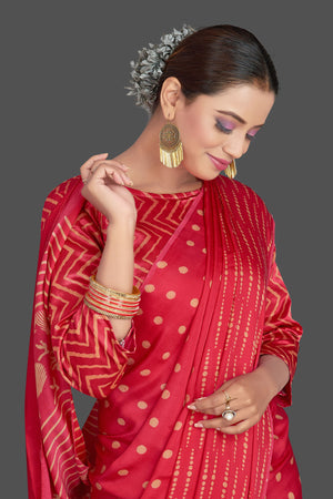 Buy gorgeous red printed modal silk sari online in USA. Make your presence felt on special occasions in beautiful embroidered sarees, handwoven sarees, pure silk sarees, tussar sarees from Pure Elegance Indian saree store in USA.-closeup