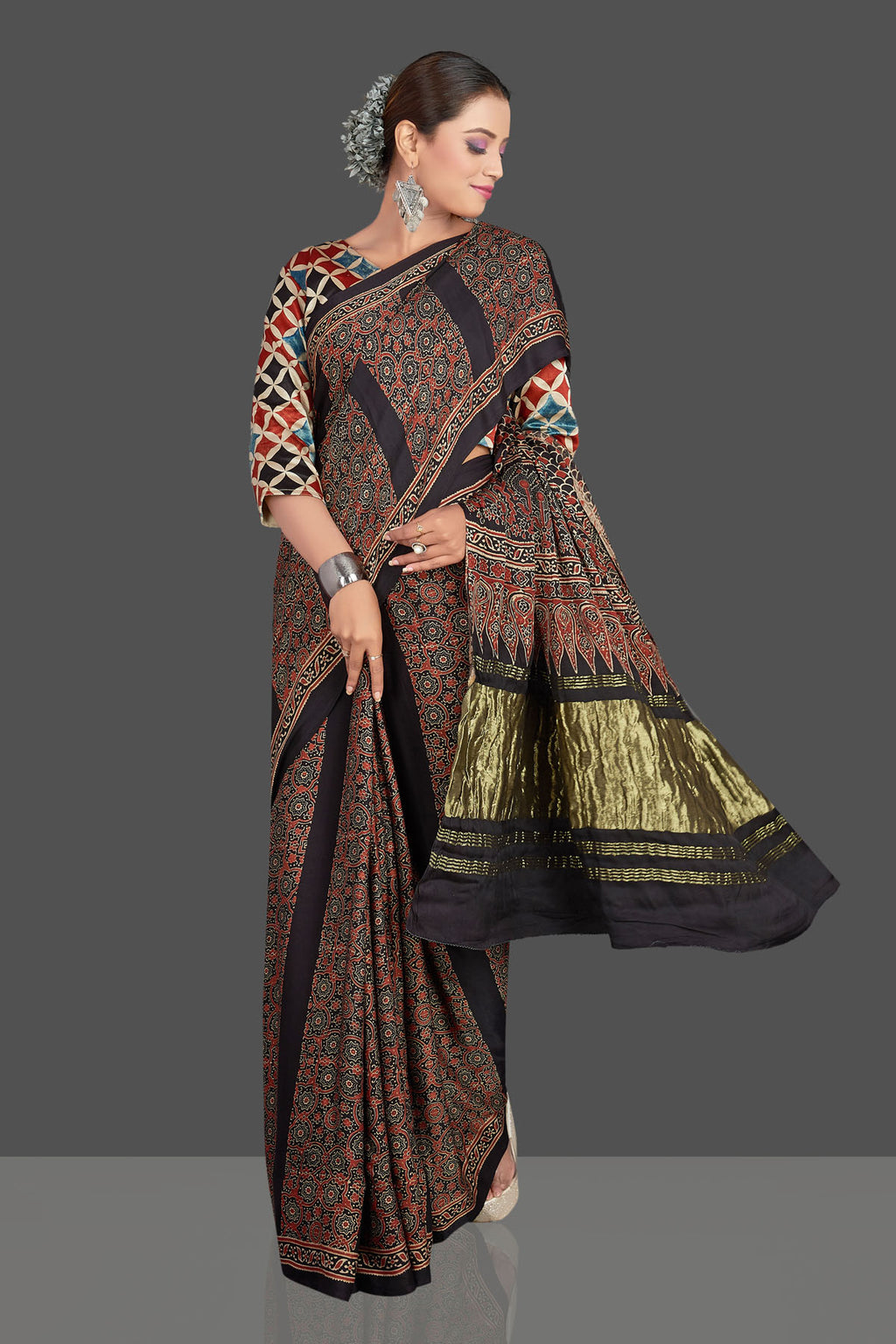 Buy stunning black Ajrakh print modal silk saree online in USA with zari pallu. Make your presence felt on special occasions in beautiful embroidered sarees, handwoven sarees, pure silk sarees, tussar sarees from Pure Elegance Indian saree store in USA.-full view