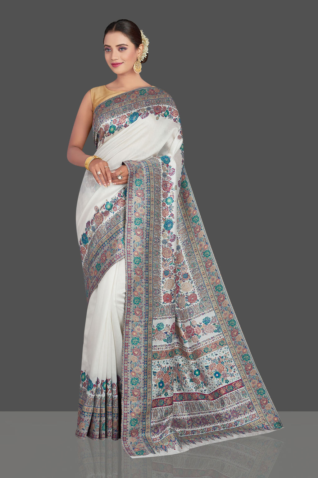 Buy stunning off-white Kani weave tussar muga silk sari online in USA. Make your presence felt on special occasions in beautiful embroidered sarees, handwoven saris, pure silk saris, tussar sarees from Pure Elegance Indian saree store in USA.-full view
