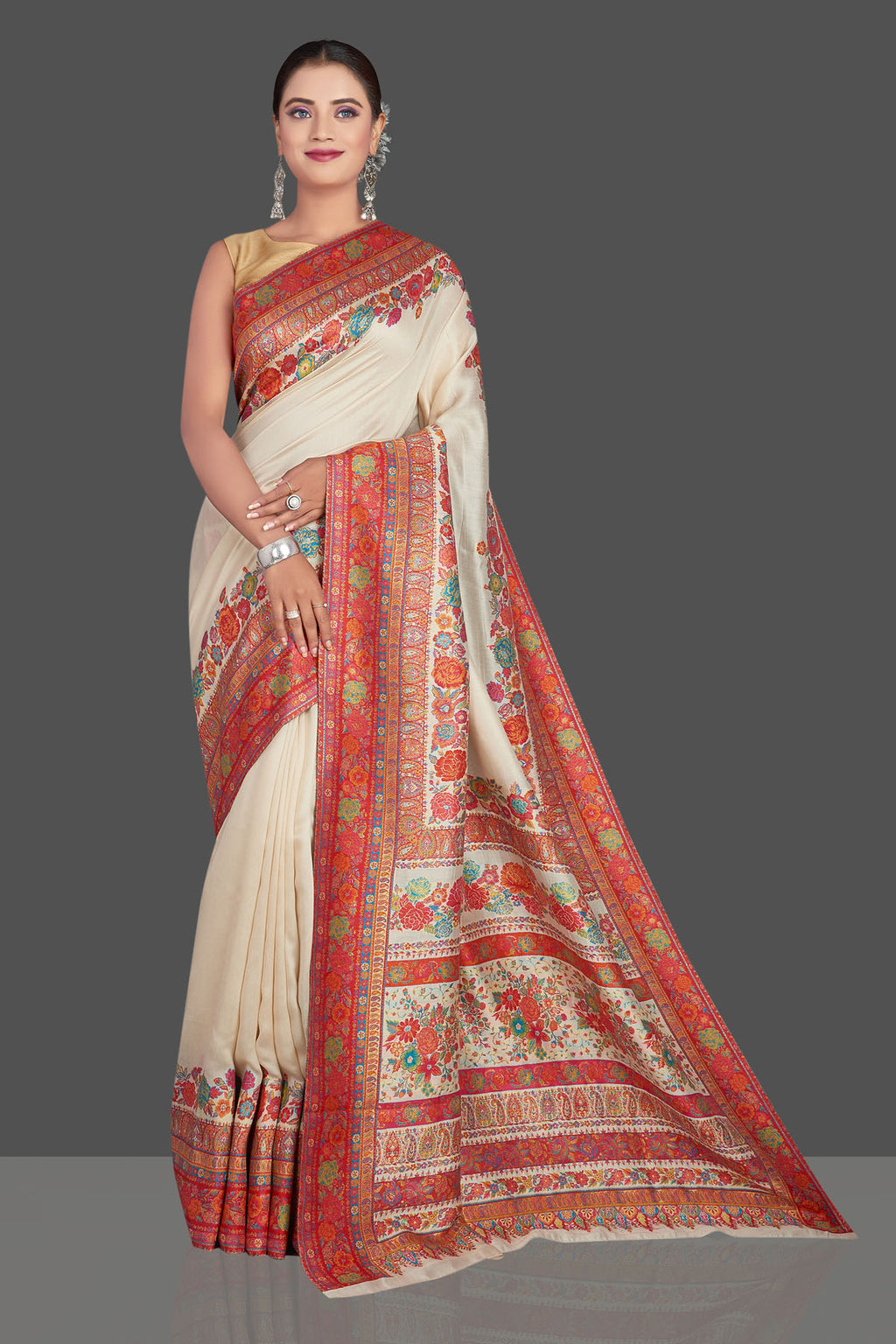 Shop stunning cream Kani weave tussar muga silk saree online in USA. Make your presence felt on special occasions in beautiful embroidered sarees, handwoven saris, pure silk saris, tussar sarees from Pure Elegance Indian saree store in USA.-full view
