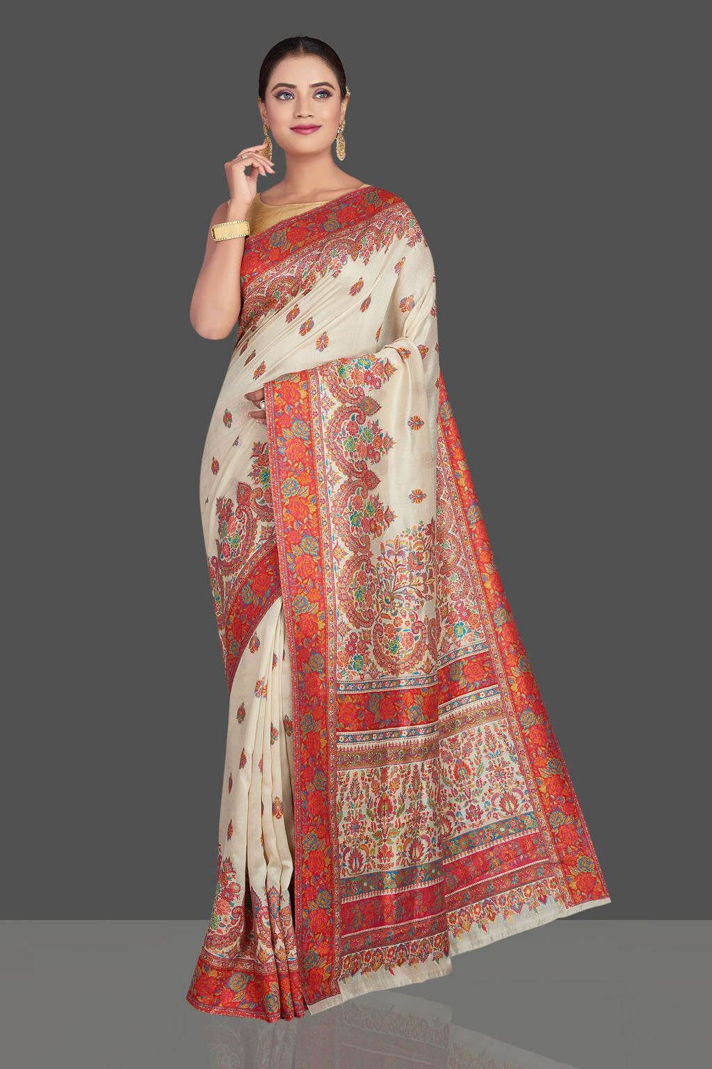 Shop stunning cream tussar muga silk saree online in USA with Kani weave. Make your presence felt on special occasions in beautiful embroidered sarees, handwoven saris, pure silk saris, tussar sarees from Pure Elegance Indian saree store in USA.-full view