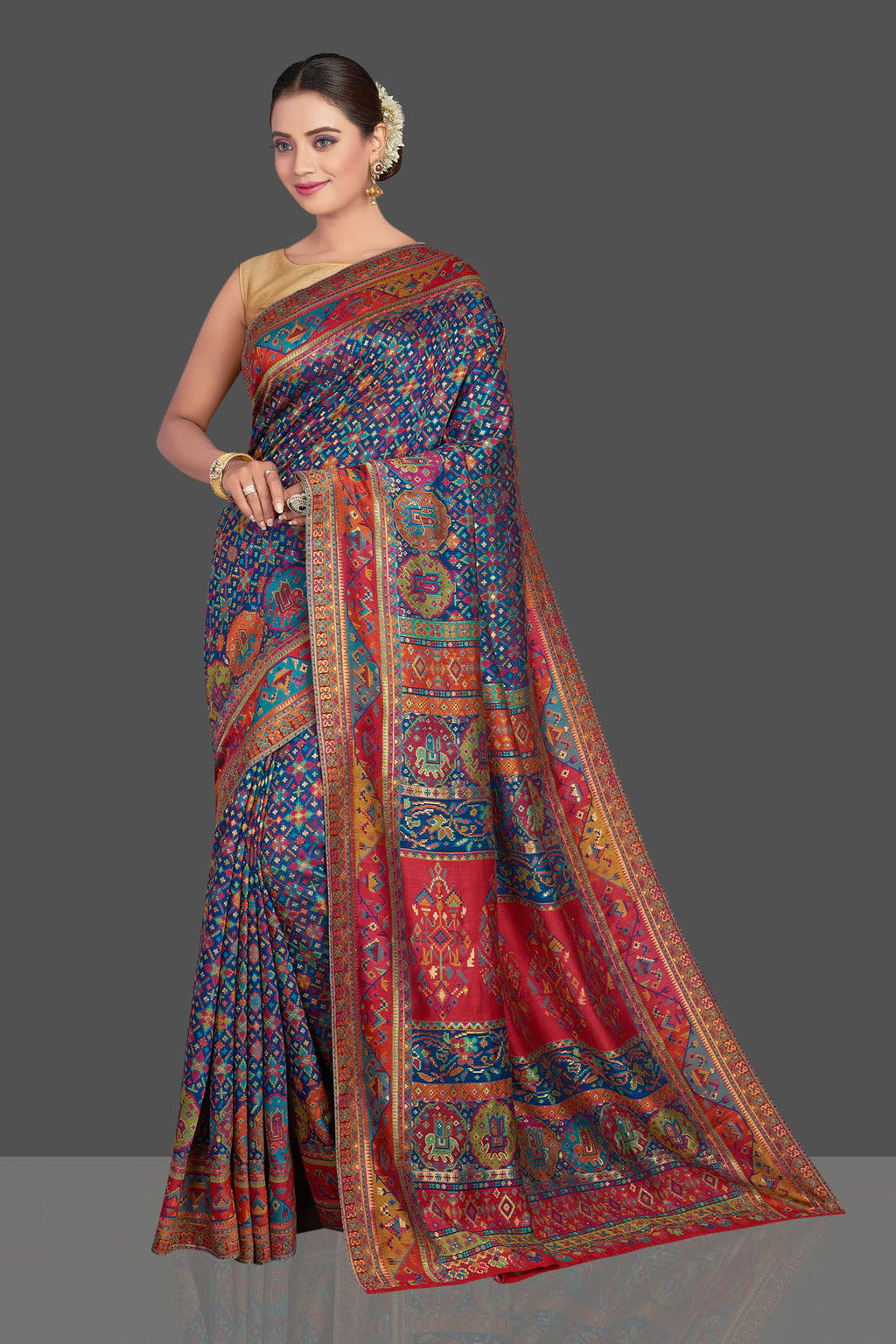 Buy gorgeous blue tussar muga silk saree online in USA with multicolor Kani weave. Make your presence felt on special occasions in beautiful embroidered sarees, handwoven saris, pure silk saris, tussar sarees from Pure Elegance Indian saree store in USA.-front