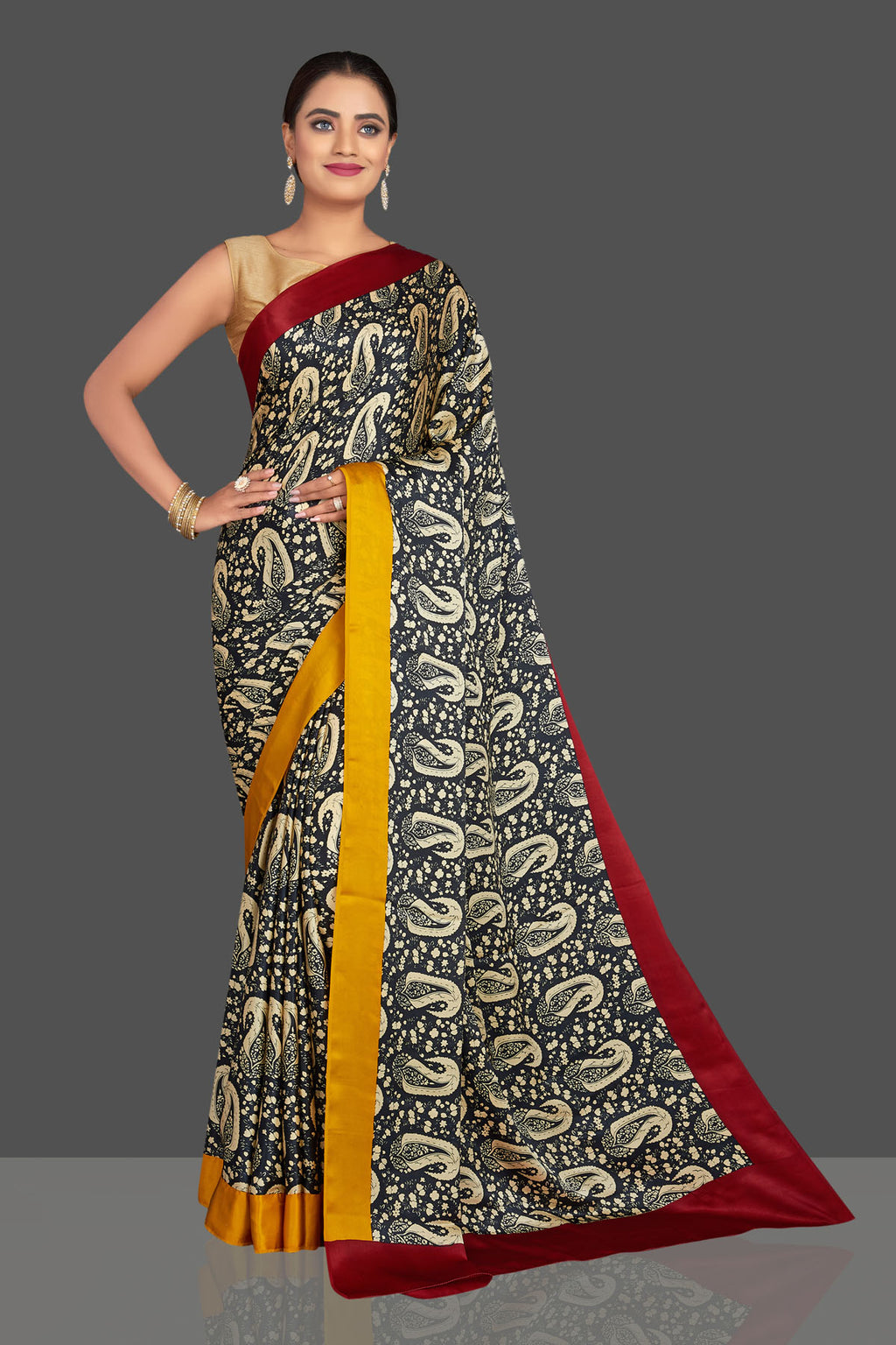 Buy stunning black printed crepe saree online in USA with yellow and red border. Shop designer sarees, printed sarees, embroidered sarees, crepe sarees in USA from Pure Elegance Indian fashion store in USA.-full view