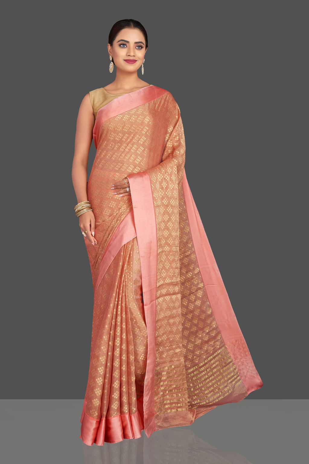Shop stunning peach crepe georgette sari online in USA with zari buta. Shop designer sarees, printed sarees, embroidered sarees, crepe sarees in USA from Pure Elegance Indian fashion store in USA.-full view