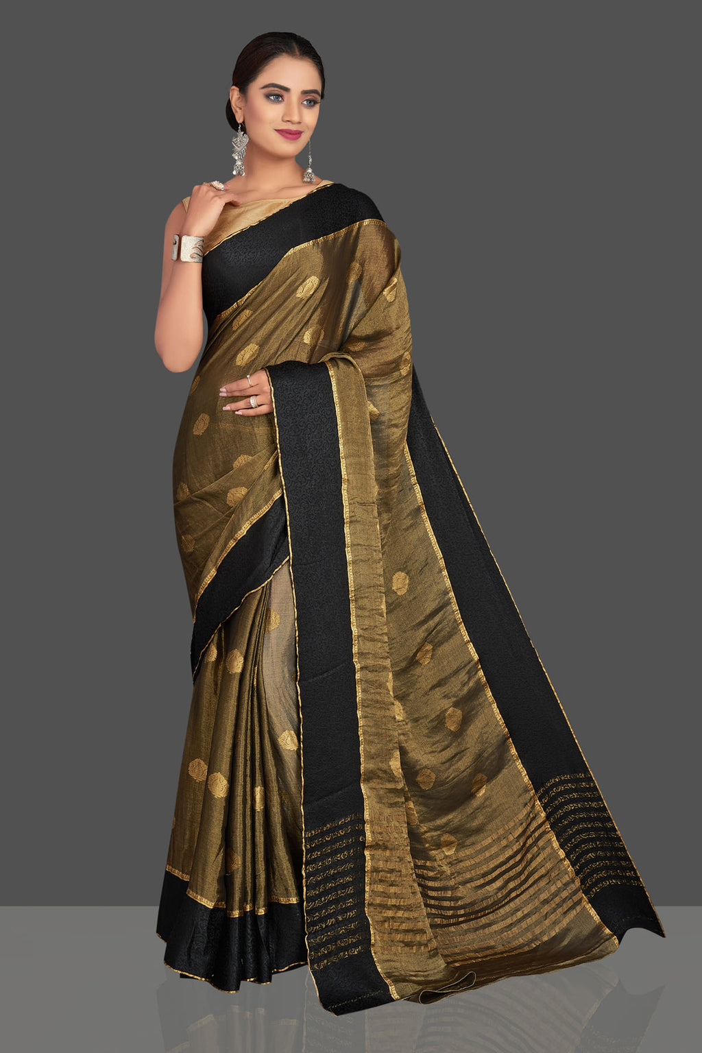 Shop beautiful dull golden tissue georgette sari online in USA with black border. Shop designer sarees, printed sarees, embroidered sarees, crepe sarees in USA from Pure Elegance Indian fashion store in USA.-full view