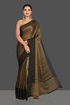 Shop beautiful dull golden tissue georgette saree online in USA with black border. Shop designer sarees, printed sarees, embroidered saris, crepe sarees in USA from Pure Elegance Indian fashion store in USA.-full view