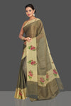Shop stunning dull gold tissue saree online in USA with floral print border. Shop designer sarees, printed sarees, embroidered sarees, crepe sarees in USA from Pure Elegance Indian fashion store in USA.-full view