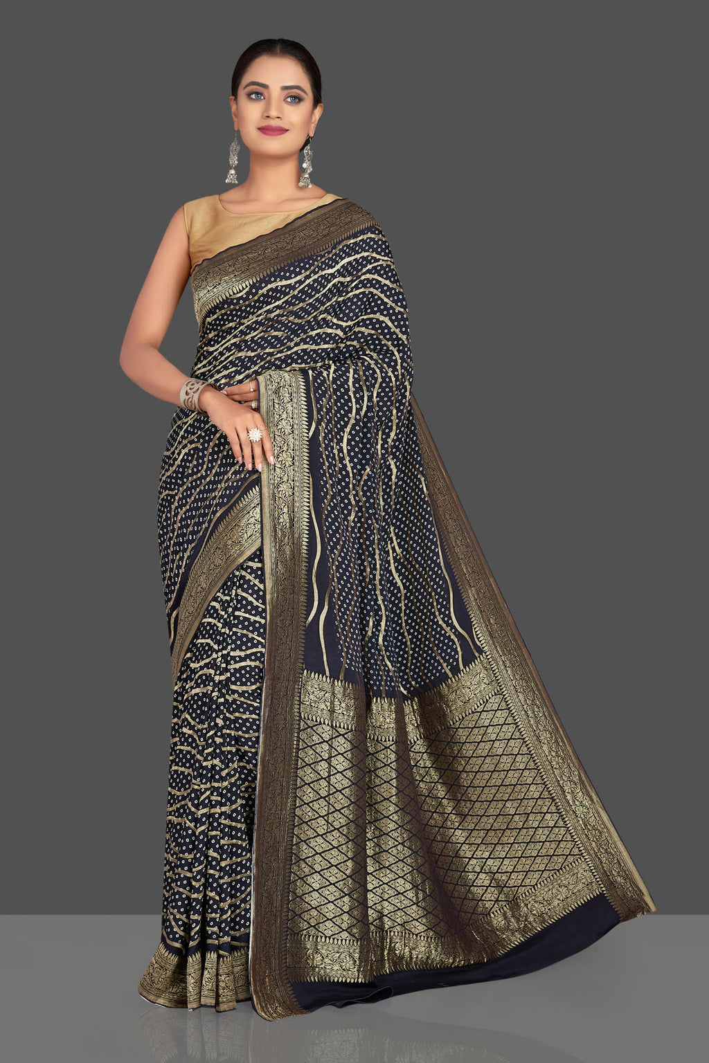 Shop beautiful navy blue crepe Banarasi saree online in USA with bandhej print. Shop designer sarees, printed sarees, embroidered sarees, crepe saris in USA from Pure Elegance Indian fashion store in USA.-front