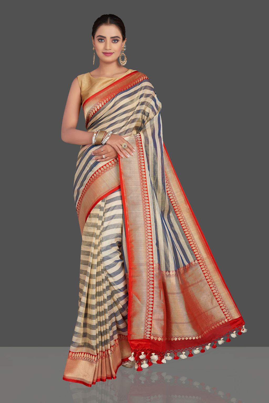 Buy beautiful grey and cream stripes tissue sari online in USA with red zari border. Be the talk of the occasion in beautiful designer sarees, tussar silk saris, georgette sarees, handloom sarees, pure silk sarees from Pure Elegance Indian saree store in USA.-full view