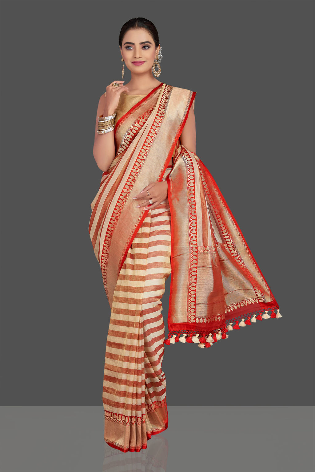Buy stunning red and cream stripes tissue saree online in USA with zari border. Be the talk of the occasion in beautiful designer sarees, tussar silk saris, georgette sarees, handloom sarees, pure silk sarees from Pure Elegance Indian saree store in USA.-full view