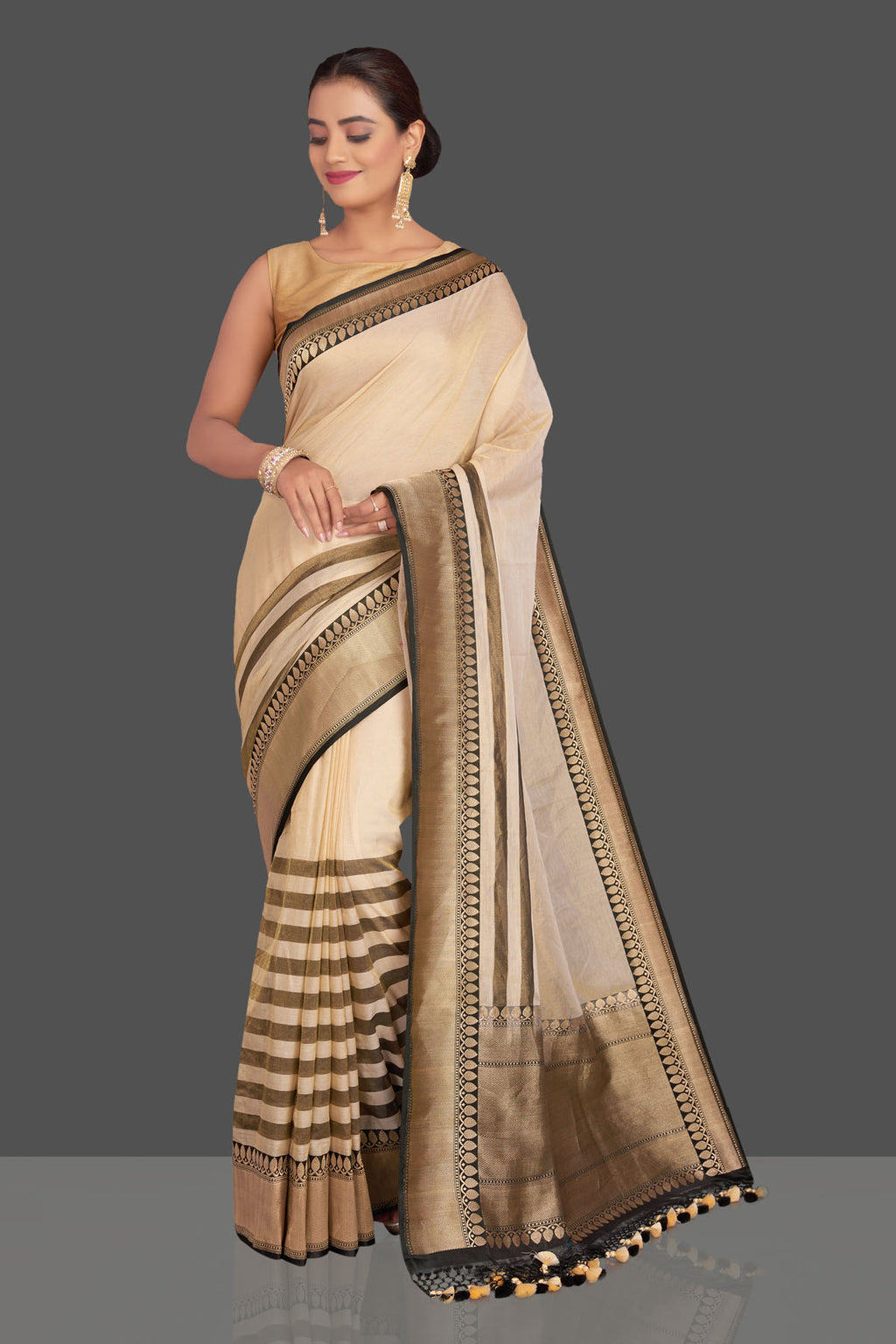 Buy gorgeous cream and golden stripes tissue saree online in USA with black zari border. Be the talk of the occasion in beautiful designer sarees, tussar silk saris, georgette sarees, handloom sarees, pure silk sarees from Pure Elegance Indian saree store in USA.-full view