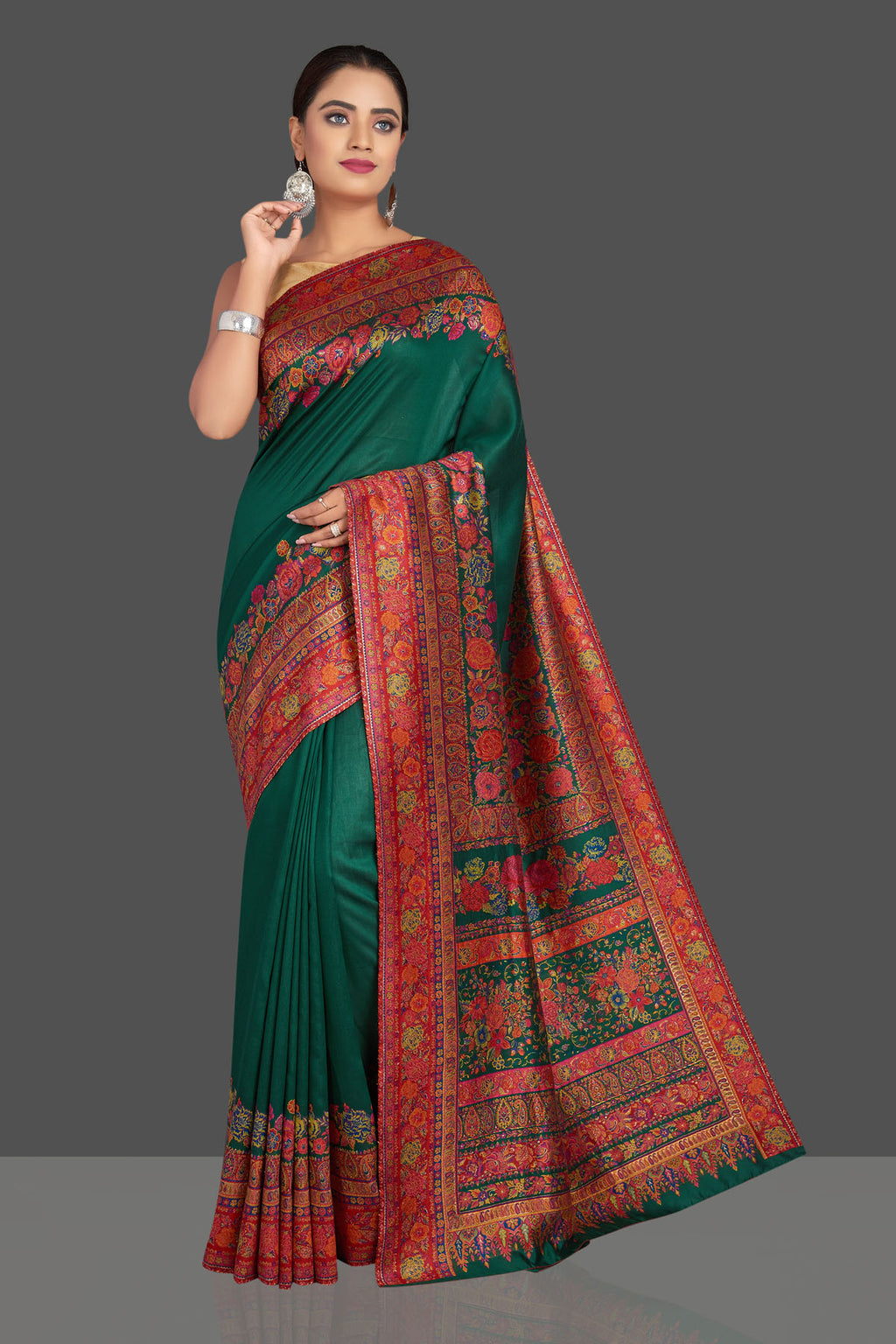 Shop stunning dark green Kani weave tussar muga sari online in USA. Shop designer sarees, printed sarees, embroidered sarees, crepe sarees in USA from Pure Elegance Indian fashion store in USA.-full view