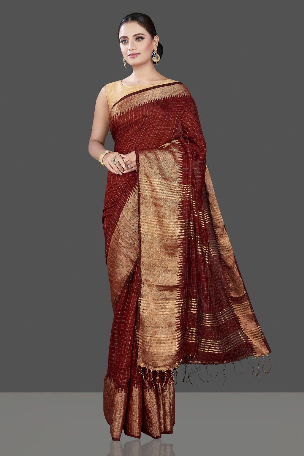 Buy stunning brown check matka silk saree online in USA with golden zari border. Be the talk of the occasion in exquisite designer sarees, pure silk sarees, tussar saris, embroidered sarees, handloom saris from Pure Elegance Indian fashion store in USA.-full view