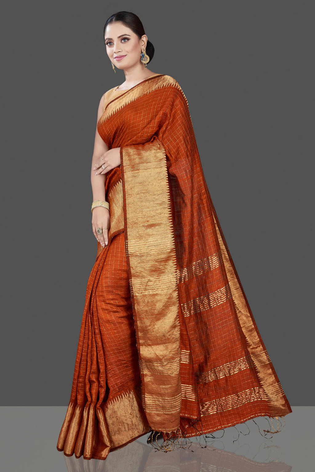 Buy beautiful rust orange matka silk saree online in USA with golden zari border. Be the talk of the occasion in exquisite designer sarees, pure silk sarees, tussar saris, embroidered sarees, handloom sarees from Pure Elegance Indian fashion store in USA.-full view