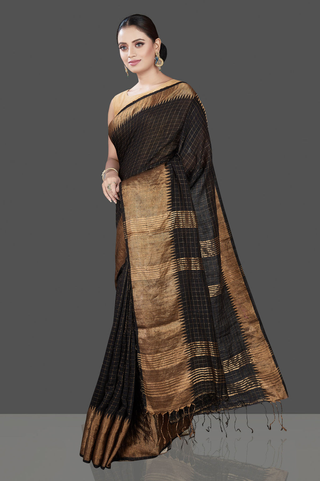 Shop gorgeous black matka silk sari online in USA with golden zari border. Be the talk of the occasion in exquisite designer sarees, pure silk sarees, tussar saris, embroidered sarees, handloom sarees from Pure Elegance Indian fashion store in USA.-full view