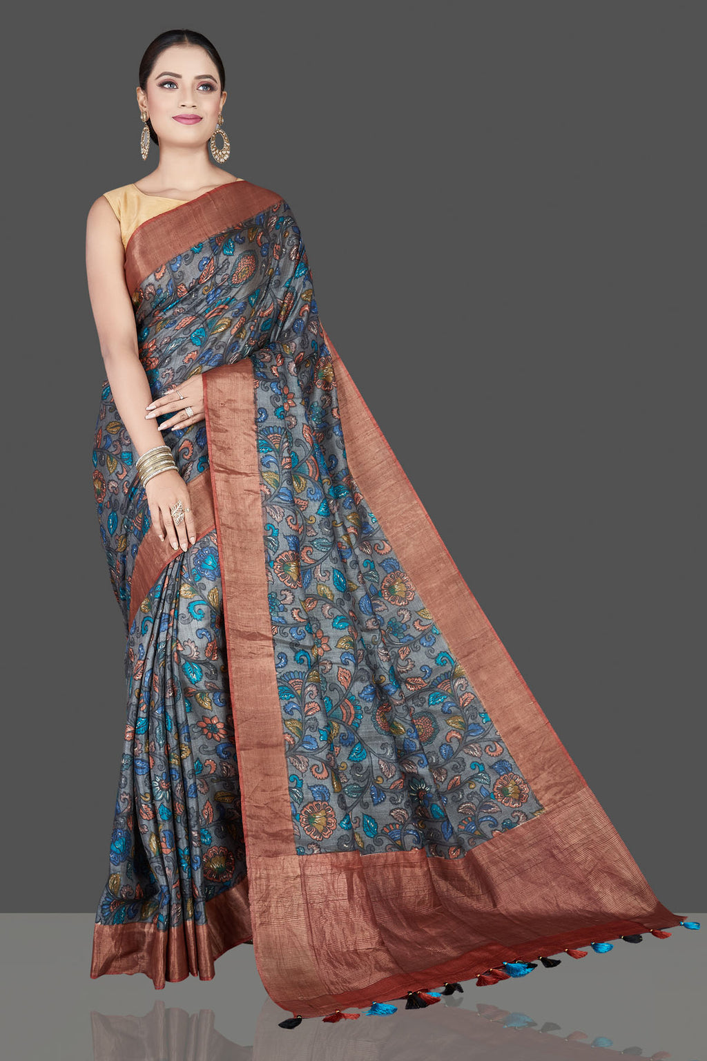 Buy beautiful grey Kalamkari print tussar silk saree online in USA with light zari border. Be the talk of the occasion in exquisite designer sarees, pure silk sarees, tussar saris, embroidered sarees, handloom sarees from Pure Elegance Indian fashion store in USA.-full view