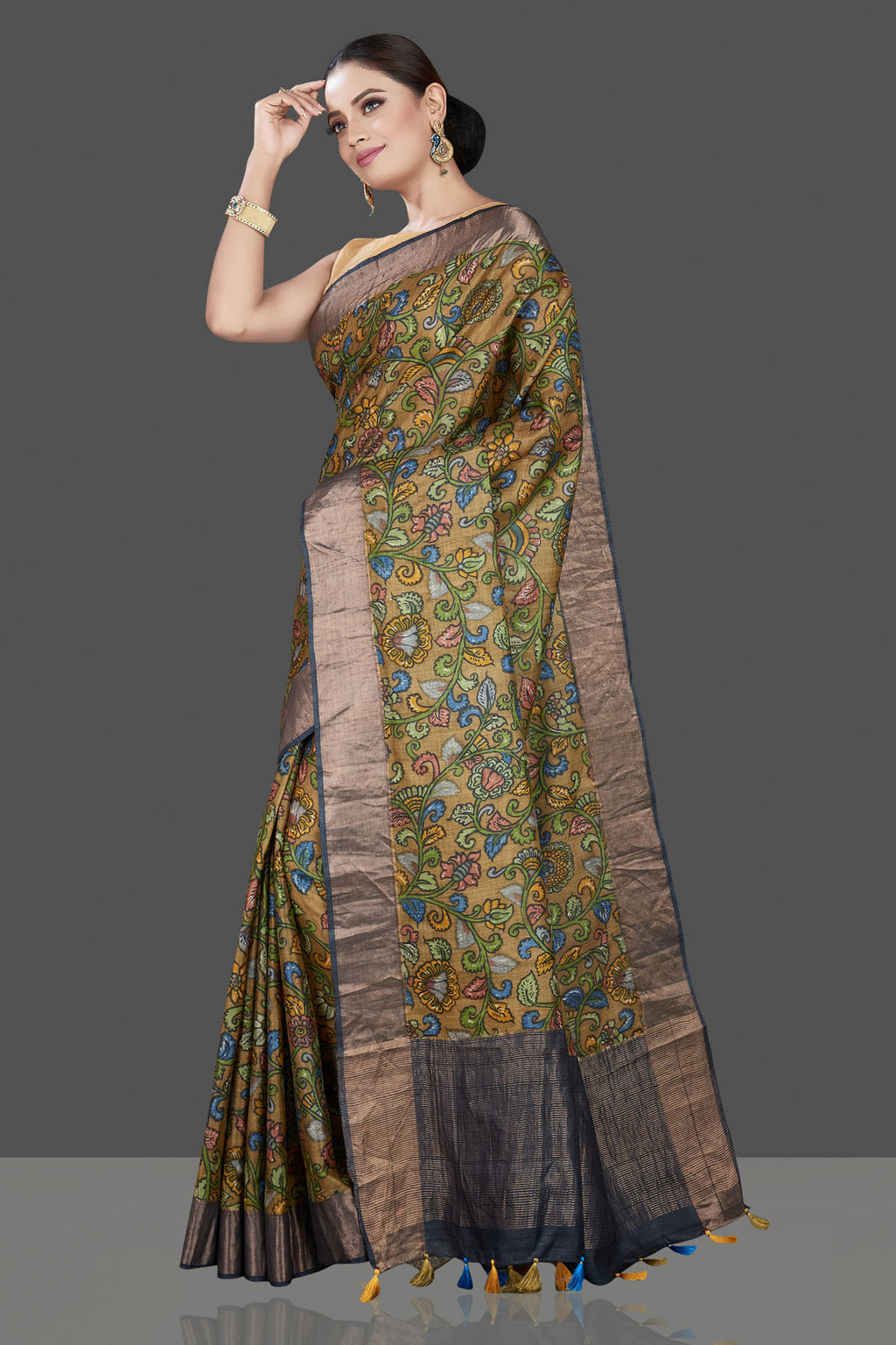 Buy stunning olive green Kalamkari print tussar silk saree online in USA with zari border. Be the talk of the occasion in exquisite designer sarees, pure silk sarees, tussar saris, embroidered sarees, handloom sarees from Pure Elegance Indian fashion store in USA.-full view