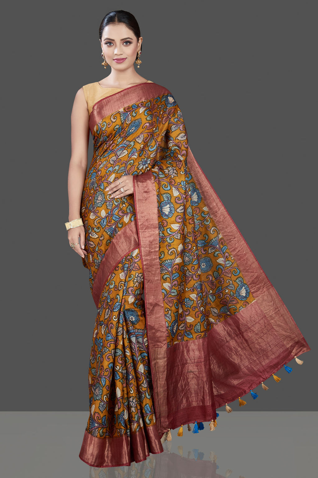 Buy beautiful mustard Kalamkari print tussar silk saree online in USA with zari border. Be the talk of the occasion in exquisite designer sarees, pure silk sarees, tussar saris, embroidered sarees, handloom sarees from Pure Elegance Indian fashion store in USA.-full view