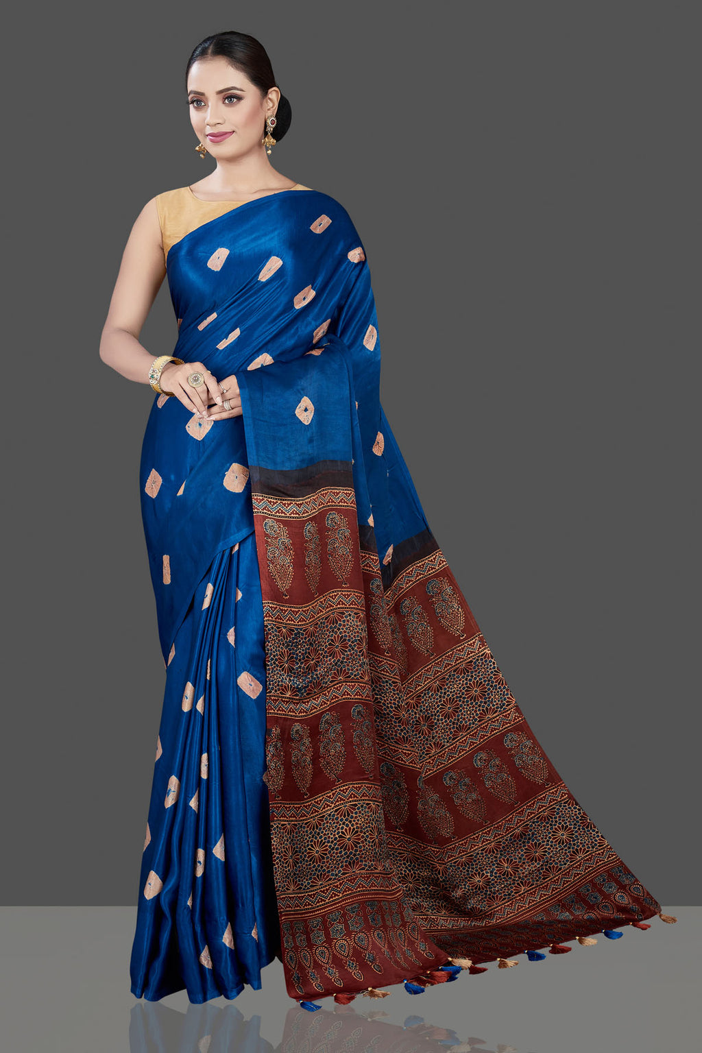 Shop stunning blue Bandhej print saree online in USA with Ajrakh pallu. Be the talk of the occasion in exquisite designer sarees, pure silk sarees, tussar saris, embroidered sarees, handloom sarees from Pure Elegance Indian fashion store in USA.-full view