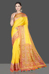 Buy stunning yellow saree online in USA with patola border and pallu. Be the talk of the occasion in exquisite designer sarees, pure silk sarees, tussar saris, embroidered sarees, handloom sarees from Pure Elegance Indian fashion store in USA.-full view