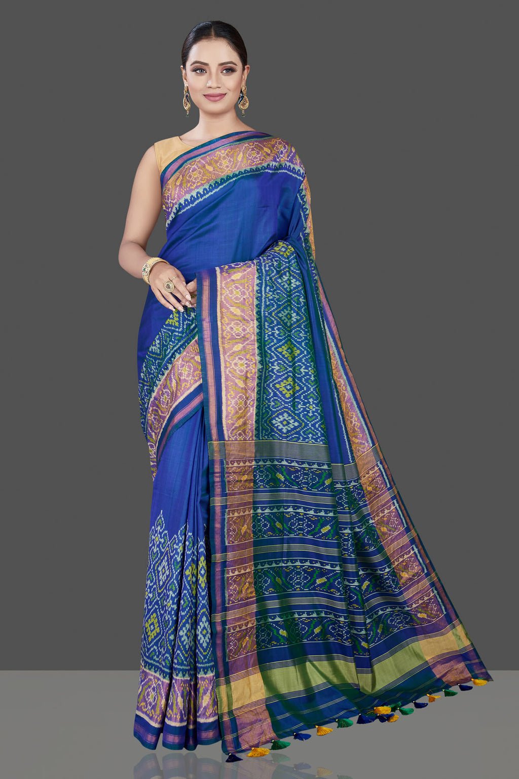 Buy beautiful blue saree online in USA with patola border and pallu. Be the talk of the occasion in exquisite designer sarees, pure silk sarees, tussar saris, embroidered sarees, handloom sarees from Pure Elegance Indian fashion store in USA.-full view