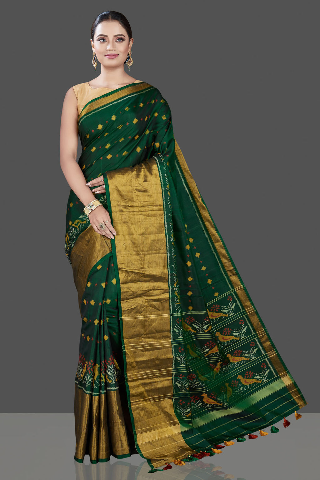 Shop stunning bottle green Patola saree online in USA with golden zari border. Be the talk of the occasion in exquisite designer sarees, pure silk sarees, tussar saris, embroidered sarees, handloom sarees from Pure Elegance Indian fashion store in USA.-full view\