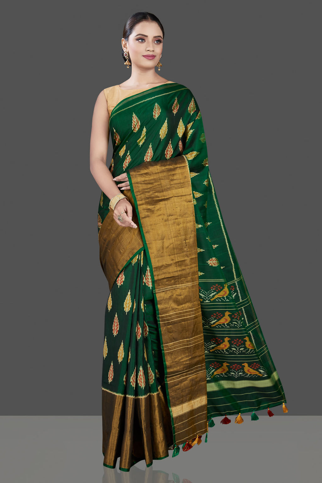 Buy beautiful bottle green Patola sari online in USA with golden zari border. Be the talk of the occasion in exquisite designer sarees, pure silk sarees, tussar saris, embroidered sarees, handloom sarees from Pure Elegance Indian fashion store in USA.-full view