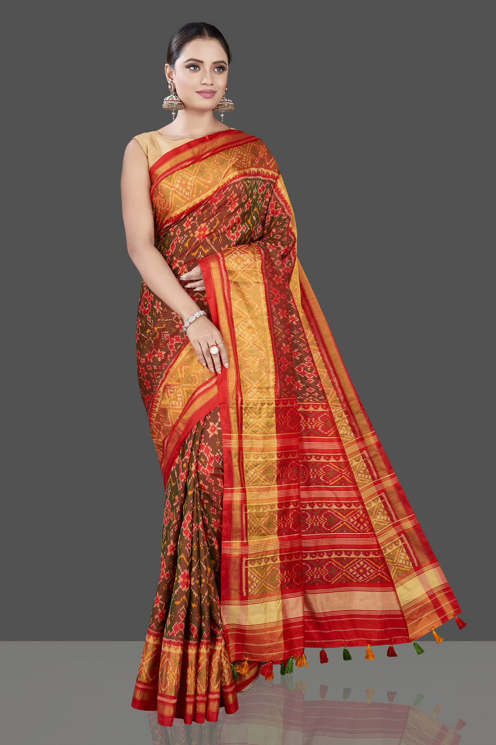 Shop beautiful brown Patola saree online in USA with golden zari border. Be the talk of the occasion in exquisite designer sarees, pure silk sarees, tussar saris, embroidered sarees, handloom sarees from Pure Elegance Indian fashion store in USA.-full view