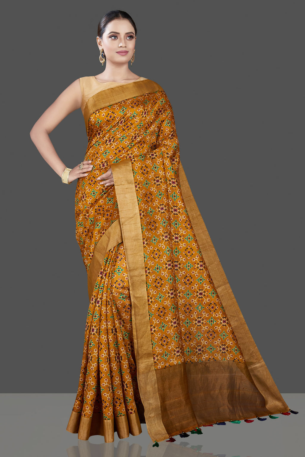 Buy stunning mustard bandhej Patola tussar silk saree online in USA with antique zari border. Be the talk of the occasion in exquisite designer sarees, pure silk sarees, tussar saris, embroidered sarees, handloom sarees from Pure Elegance Indian fashion store in USA.-full view