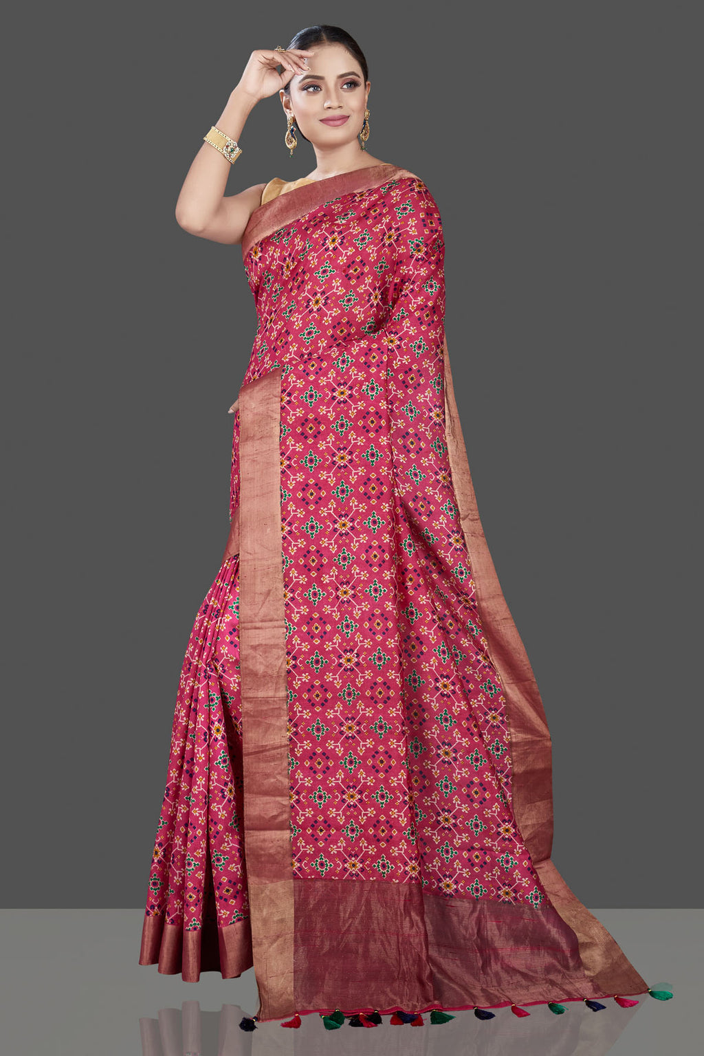Buy beautiful pink bandhej Patola tussar silk sari online in USA with antique zari border. Be the talk of the occasion in exquisite designer sarees, pure silk sarees, tussar saris, embroidered sarees, handloom sarees from Pure Elegance Indian fashion store in USA.-full view