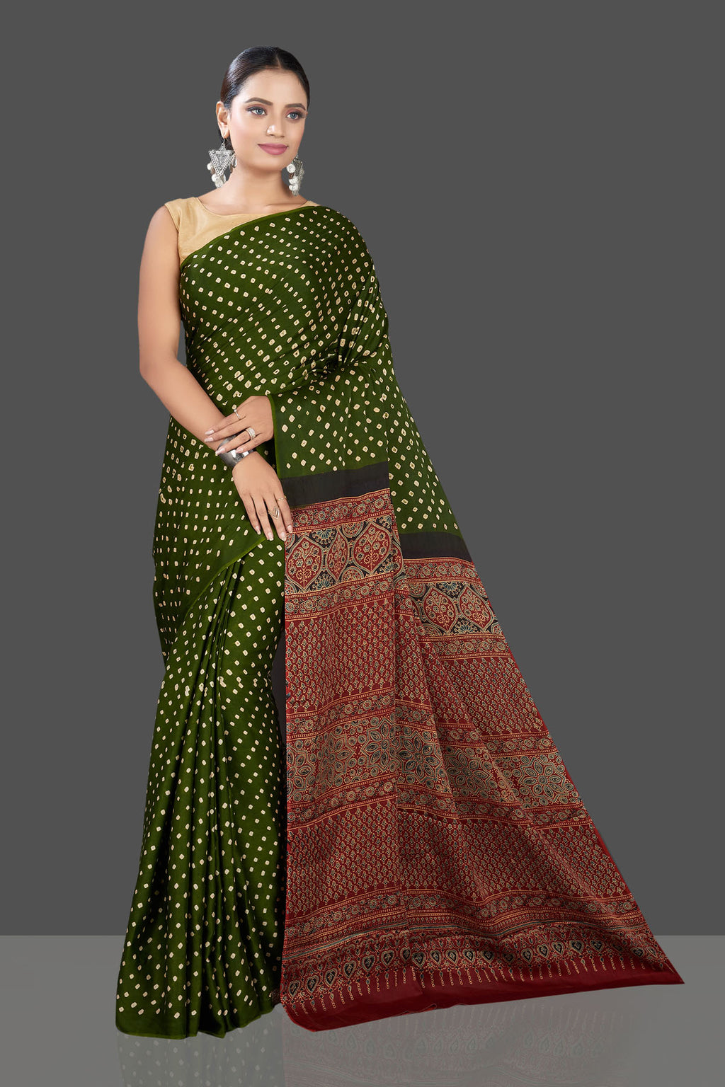 Buy gorgeous green Bandhej print modal silk sari online in USA with red Ajrakh pallu. Look beautiful at weddings and parties with exquisite designer sarees, handwoven saris, pure silk sarees, embroidered sarees, printed sarees from Pure Elegance Indian fashion boutique in USA.-full view