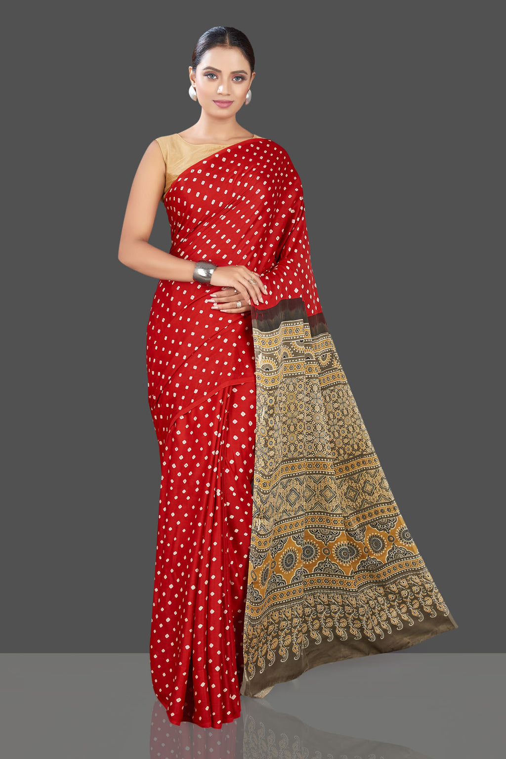 Shop beautiful red Bandhej print modal silk sari online in USA with Ajrakh pallu. Look beautiful at weddings and parties with exquisite designer sarees, handwoven saris, pure silk sarees, embroidered sarees, printed sarees from Pure Elegance Indian fashion boutique in USA.-full view