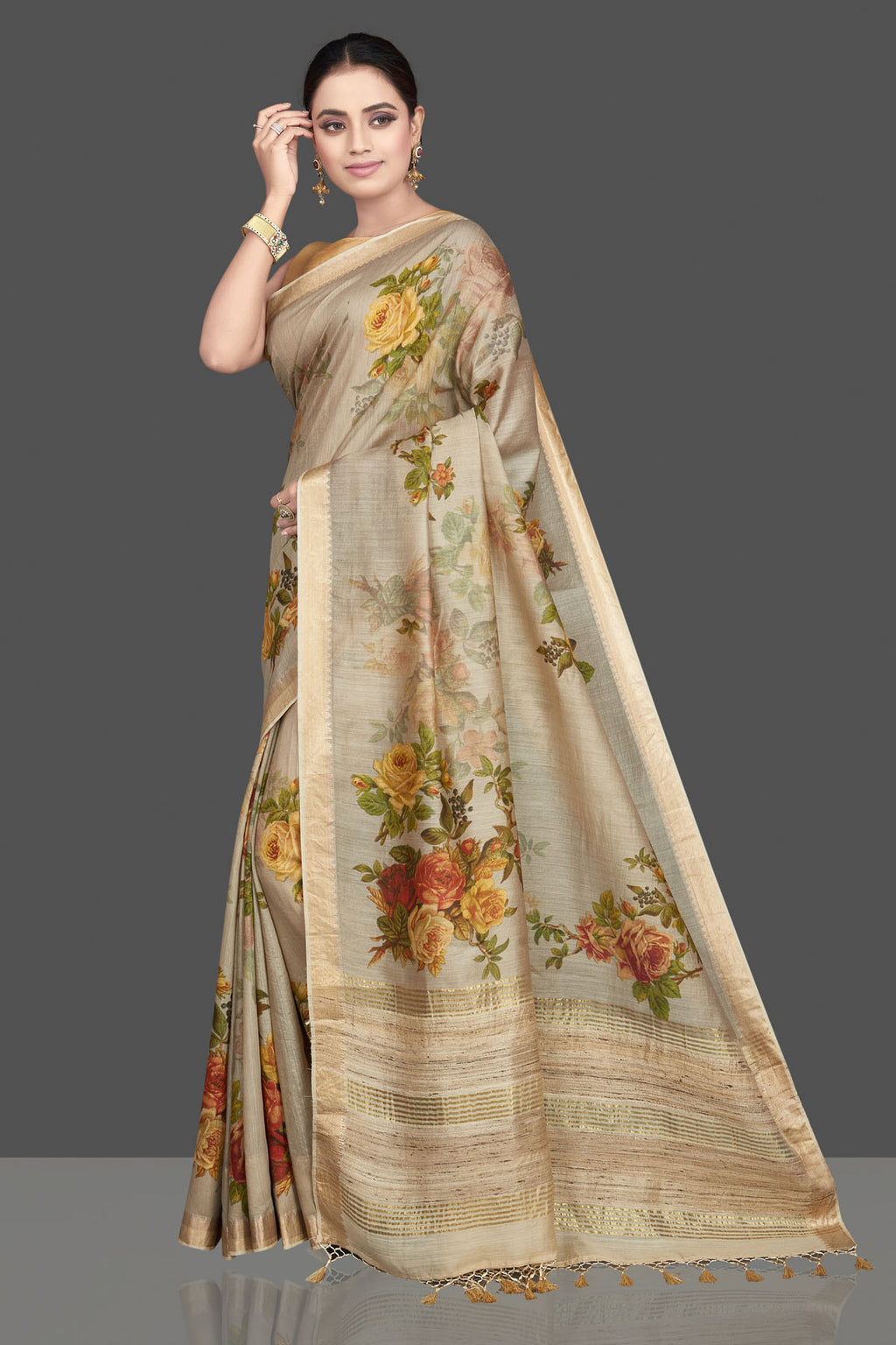Shop gorgeous beige floral print Muga silk sari online in USA with golden border. Look attractive on weddings and parties in beautiful designer sarees, pure silk sarees, handwoven saris, embroidered sarees, zari work sarees from Pure Elegance Indian saree store in USA. -full view