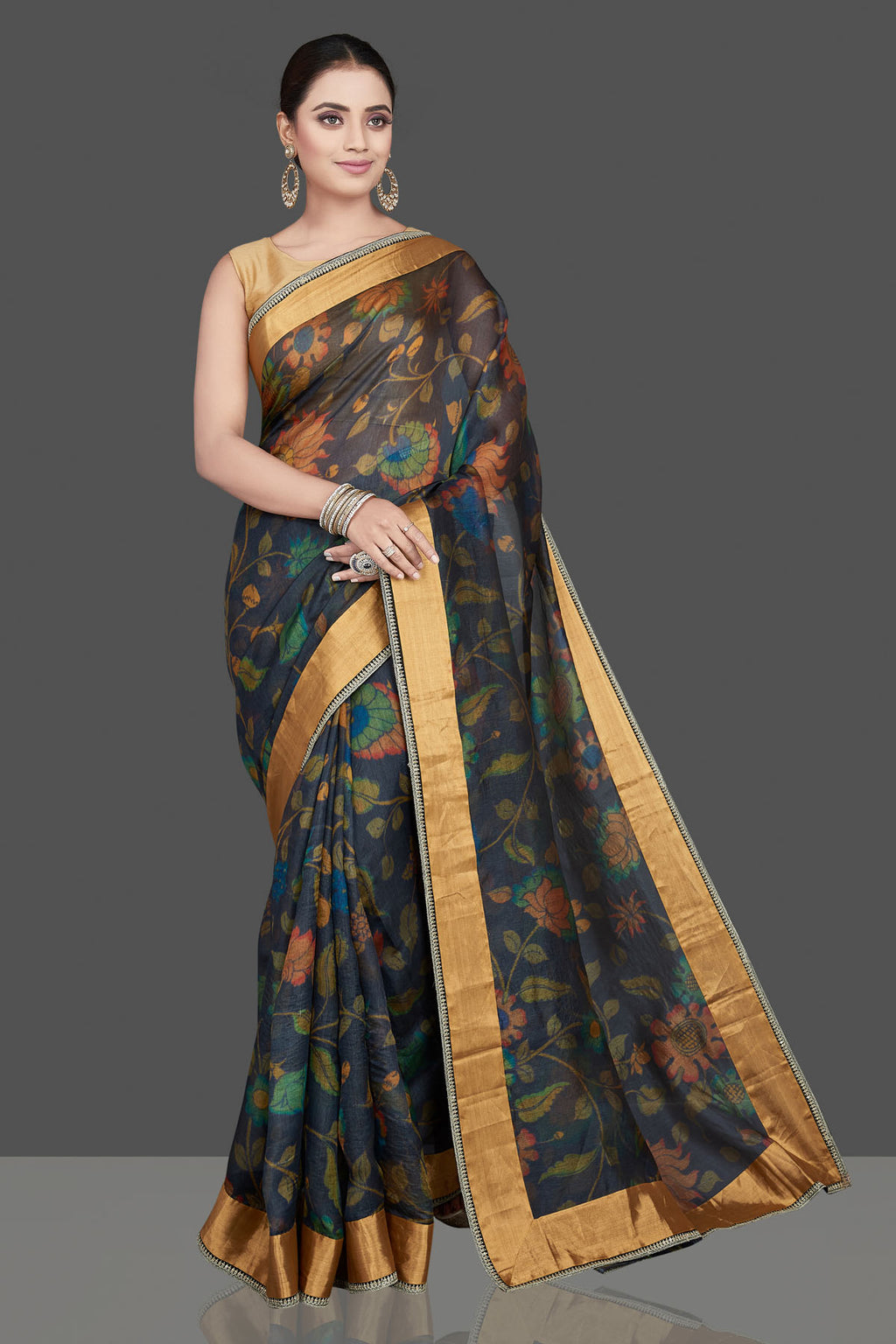 Buy gorgeous black Kalamkari print silk saree online in USA with embroidered golden border. Look attractive on weddings and parties in beautiful designer sarees, pure silk sarees, handwoven saris, embroidered sarees, zari work sarees from Pure Elegance Indian saree store in USA. -full view