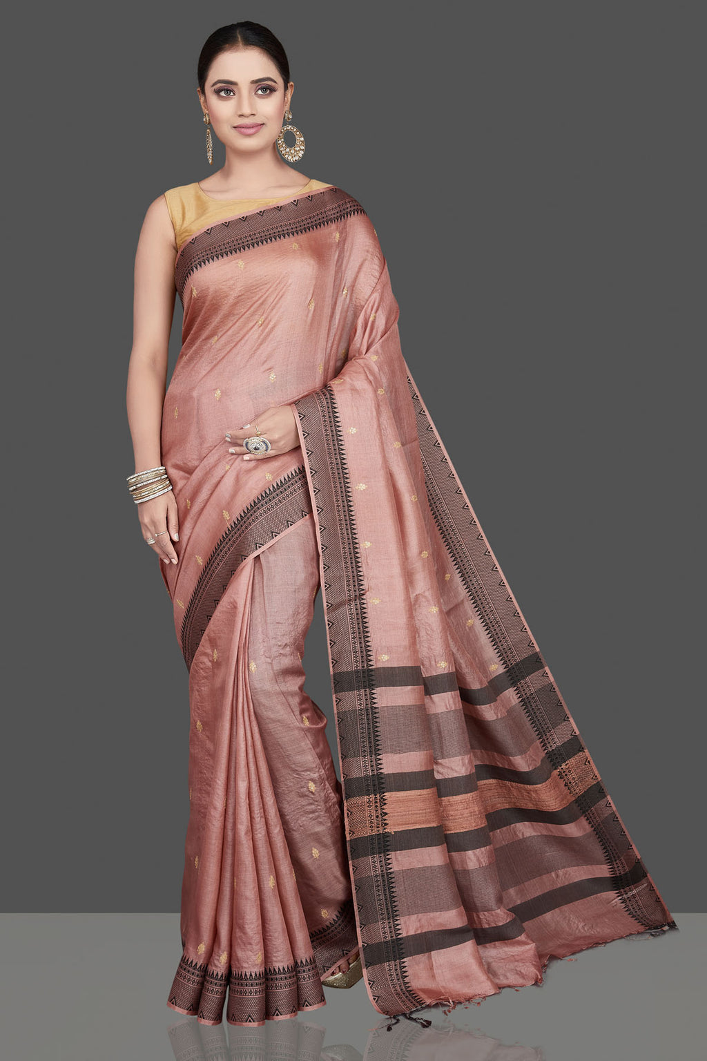 Shop beautiful dusty pink embroidered tussar silk saree online in USA. Look attractive on weddings and parties in beautiful designer sarees, pure silk sarees, handwoven saris, embroidered sarees, zari work sarees from Pure Elegance Indian saree store in USA. -full view