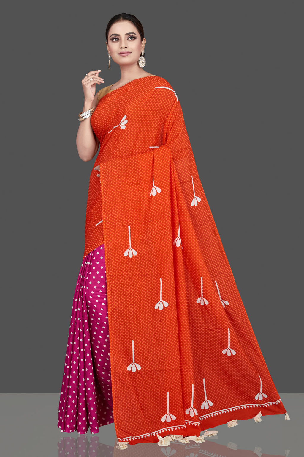 Shop stunning red and pink printed modal silk saree online in USA. Be the highlight of the occasion in beautiful pure silk saree, designer saris, handloom sarees, embroidered sarees, Kanchipuram sarees, Banarasi saris from Pure Elegance Indian saree store in USA.-full view