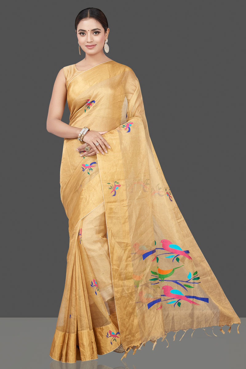 Shop gorgeous beige Uppada tissue sari online in USA with bird weave motifs. Flaunt ethnic fashion on special occasions in stunning georgette sarees, designer sarees, embroidered sarees, pure silk sarees, Kanchipuram sarees from Pure Elegance Indian fashion store in USA.-full view