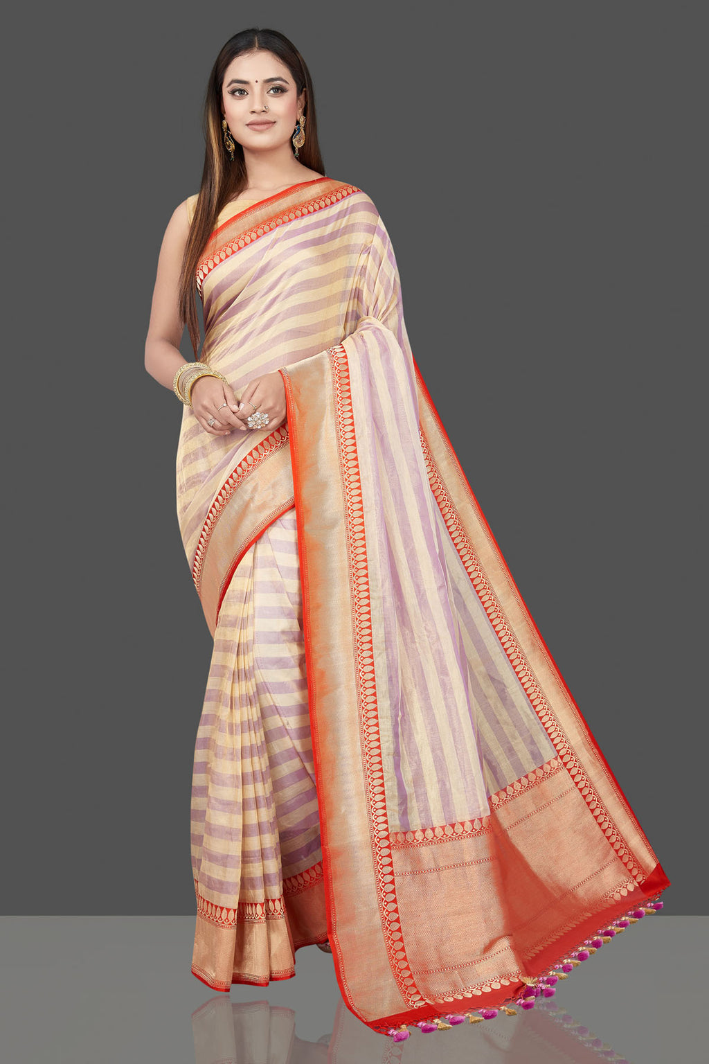 Shop beautiful lilac and cream stripes tissue cotton sari online in USA with red zari border. Flaunt ethnic fashion on special occasions in stunning georgette sarees, designer saris, embroidered sarees, pure silk sarees, Kanchipuram sarees from Pure Elegance Indian fashion store in USA.-full view