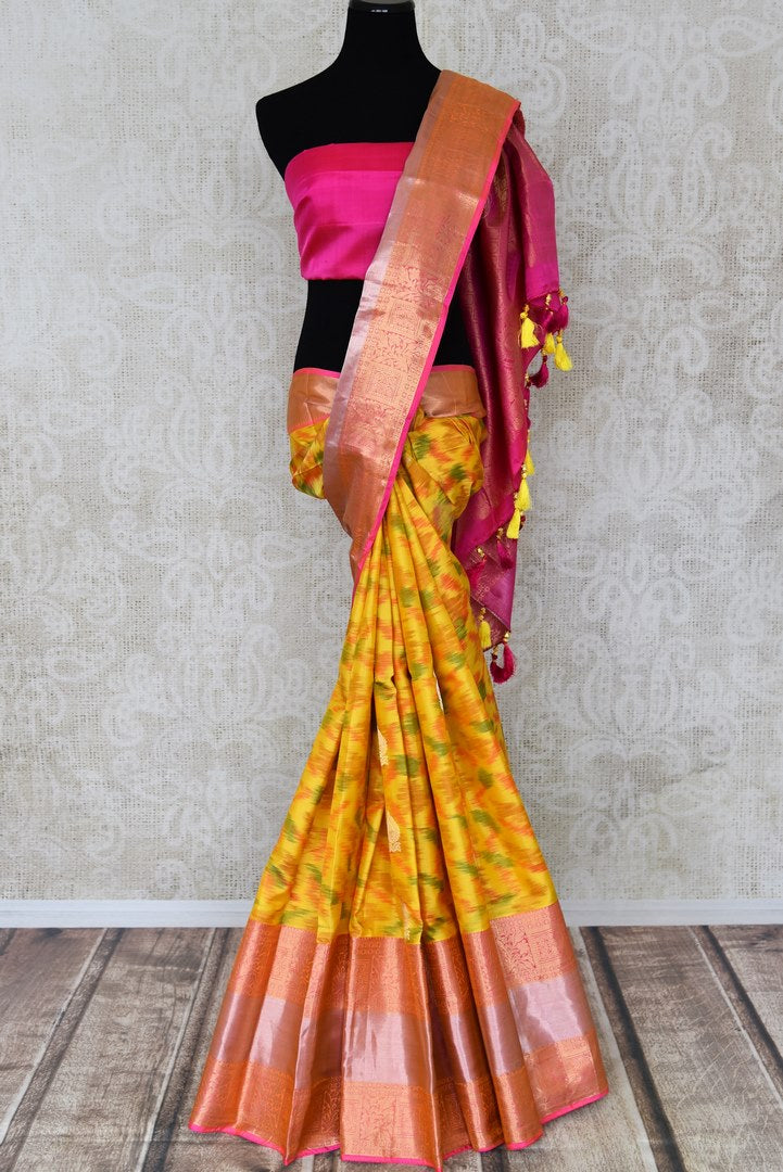 Shop stunning yellow Kanji ikkat sari online in USA with pink zari border. Look attractive on special occasions in the beautiful silk sarees, designer saris, embroidered sarees, handwoven saris from Pure Elegance Indian fashion store in USA.-full view