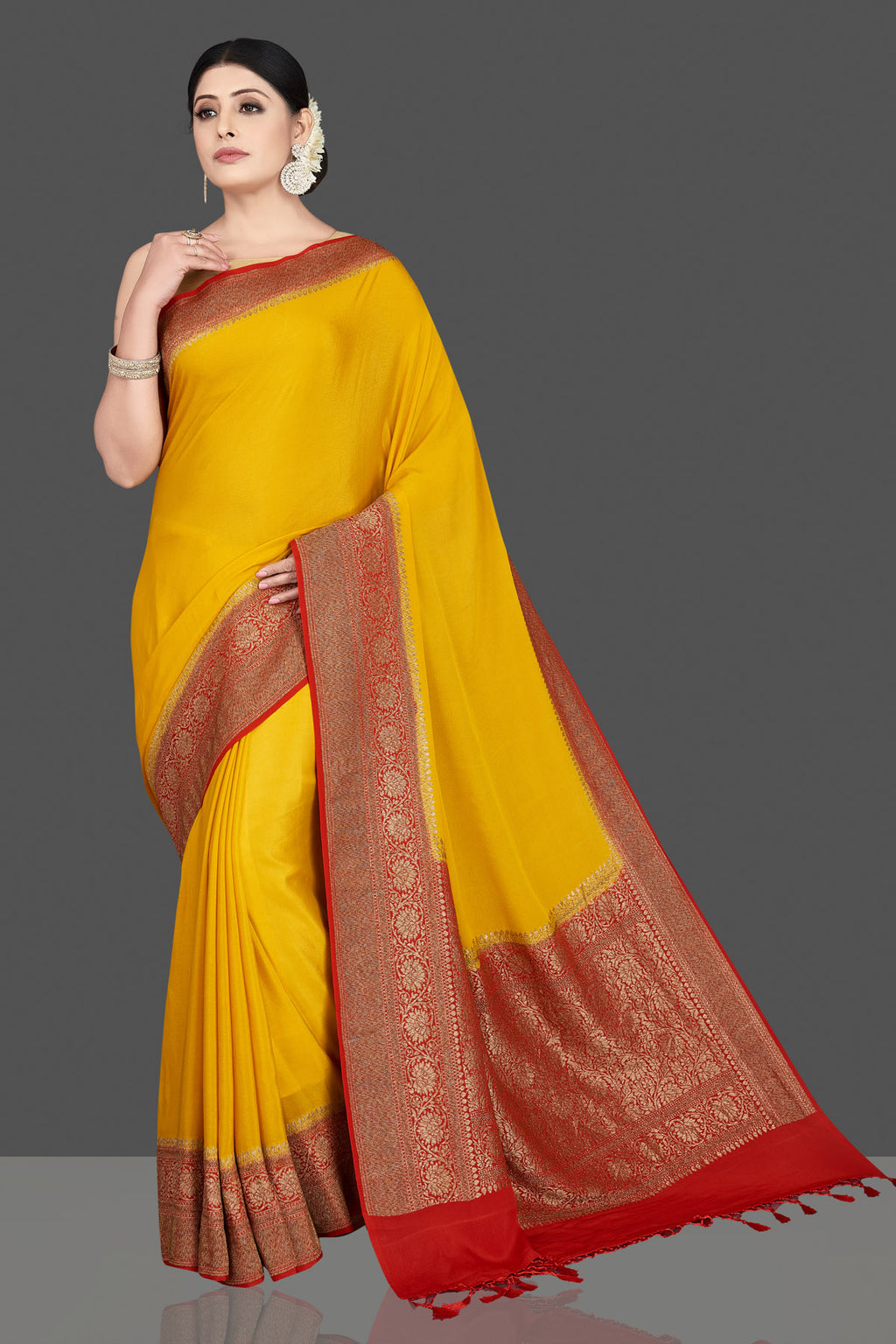 Buy beautiful mustard tussar silk saree online in USA with red zari border. Be the center of attraction at weddings and special occasions in exquisite designer sarees, handwoven silk saris, embroidered sarees, pure silk sarees from Pure Elegance Indian fashion store in USA.-full view