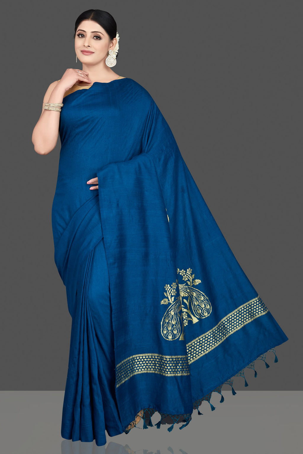 Shop stunning blue muga silk sari online in USA with zari motifs on pallu. Be the center of attraction at weddings and special occasions in exquisite designer sarees, handwoven silk saris, embroidered sarees, pure silk sarees from Pure Elegance Indian fashion store in USA.-full view
