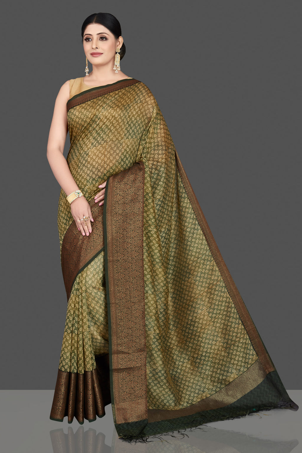 Buy beautiful olive green chanderi cotton silk saree online in USA with antique zari border. Be the center of attraction at weddings and special occasions in exquisite designer sarees, handwoven silk sarees, embroidered saris, pure silk sarees from Pure Elegance Indian fashion store in USA.-full view