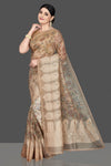 Buy stunning beige Kalamkari organza sari online in USA with embroidered border. Be the center of attraction at weddings and special occasions in exquisite designer sarees, handwoven silk sarees, embroidered saris, pure silk sarees from Pure Elegance Indian fashion store in USA.-full view