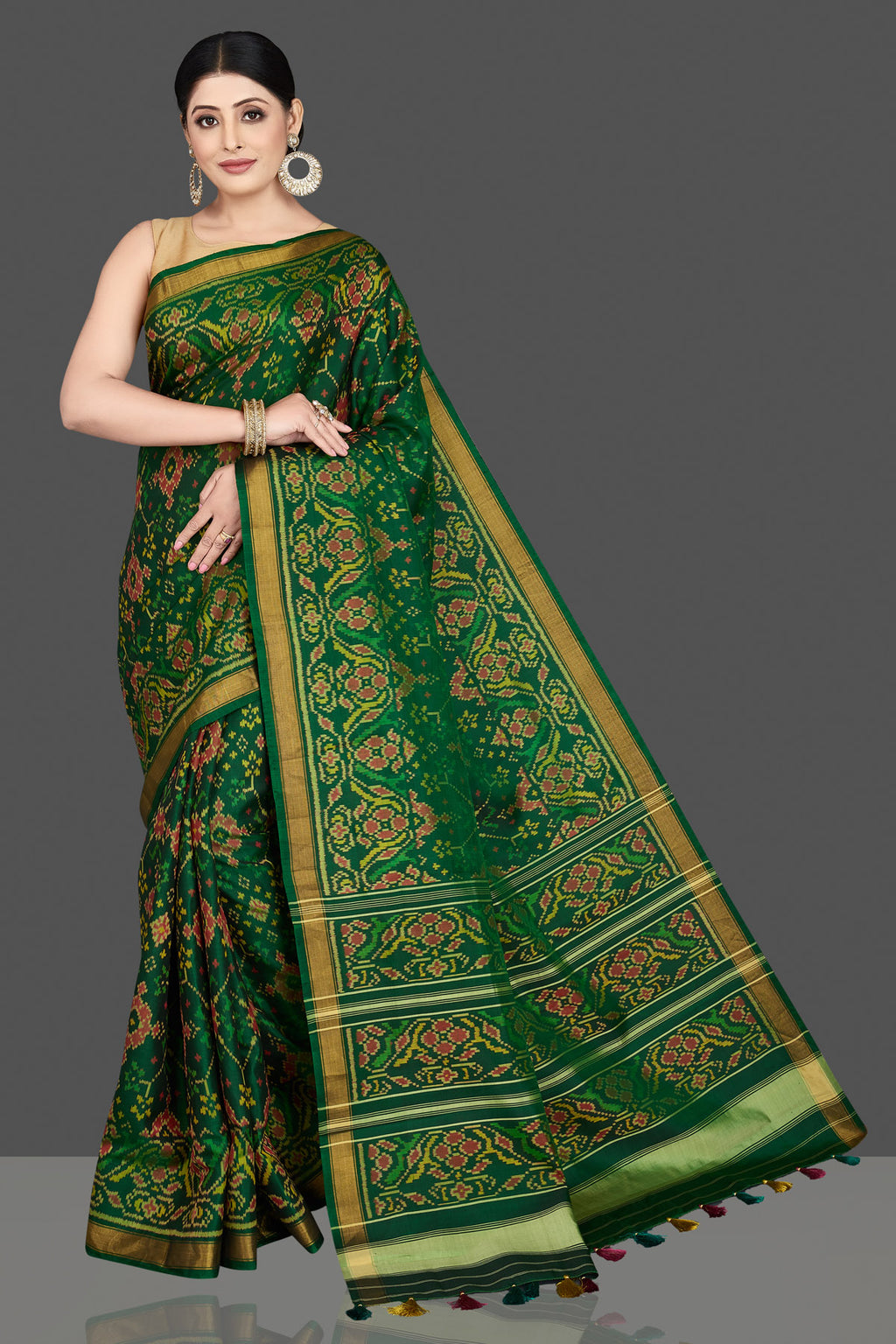 Shop stunning green patola ikkat sari online in USA with golden border. Be the center of attraction at weddings and special occasions in exquisite designer sarees, handwoven silk sarees, embroidered saris, pure silk sarees from Pure Elegance Indian fashion store in USA.-full view
