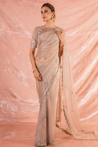 Buy beautiful pink embroidered organza saree online in USA with saree blouse. saree has simple silver border work. Blouse is of elbow length and has embroidery work. Be the talk of parties and weddings with exquisite designer sarees, embroidered sarees from Pure Elegance Indian clothing store in USA. Shop online now.-full view